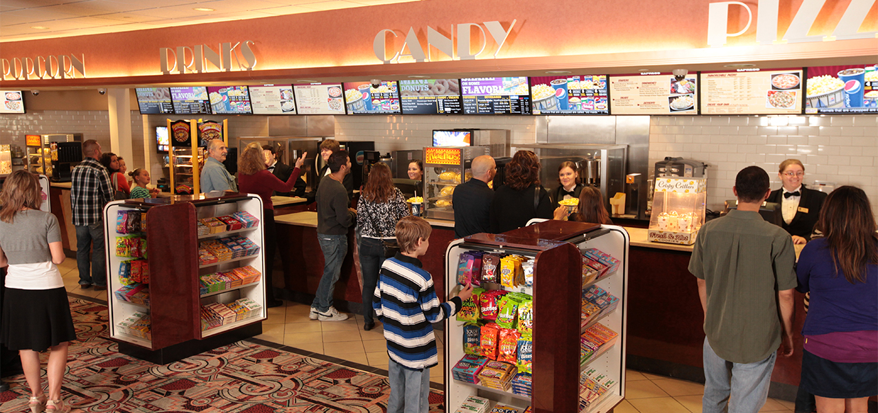 Concession stand and customers at the Marcus Point Cinema movie theater, a construction project of Tri-North Builders in Wisconsin