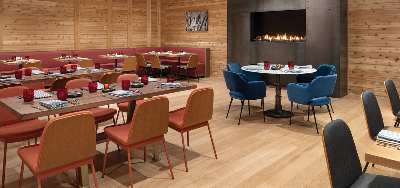 Dining area and fireplace in the Tri-North remodeled Radisson Hotel & Conference Center Green Bay.