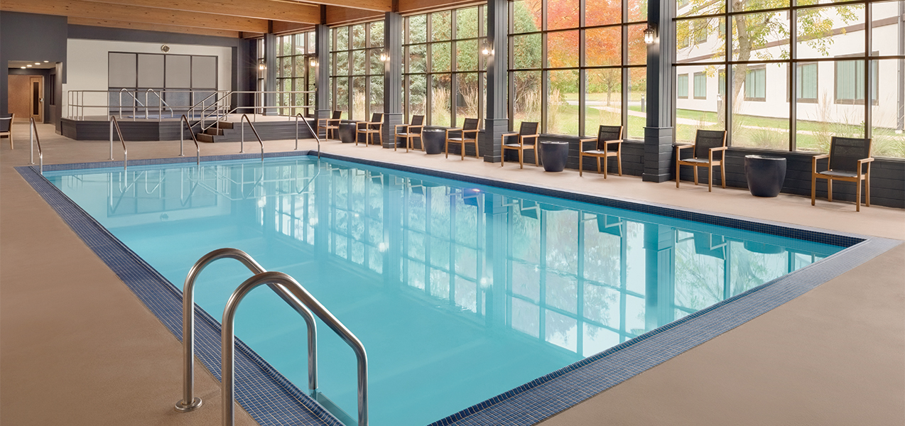 Indoor pool and seating area inside the Radisson Hotel & Conference Center Green Bay in Wisconsin.