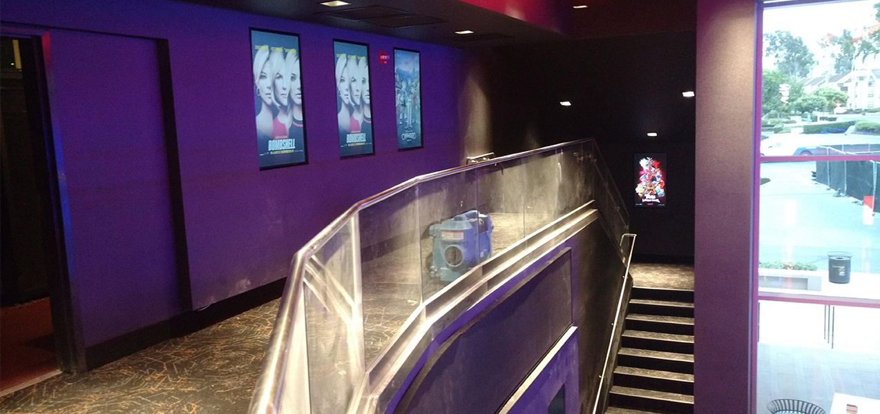 Stairs leading to screening rooms inside the Regal Cinema movie theater which is a Tri-North Builders project.