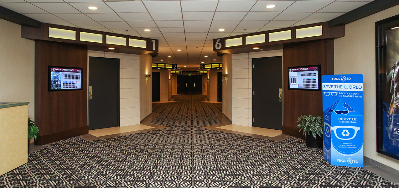 Tri-North Builders Rosemont theater showing the hallway and doors to the screening rooms.