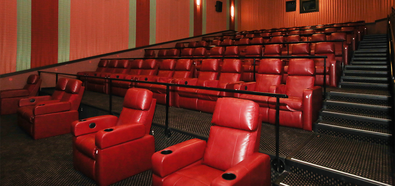 Stadium seating inside screening room at the Rosemont movie theater in Illinois remodeled by Tri-North.