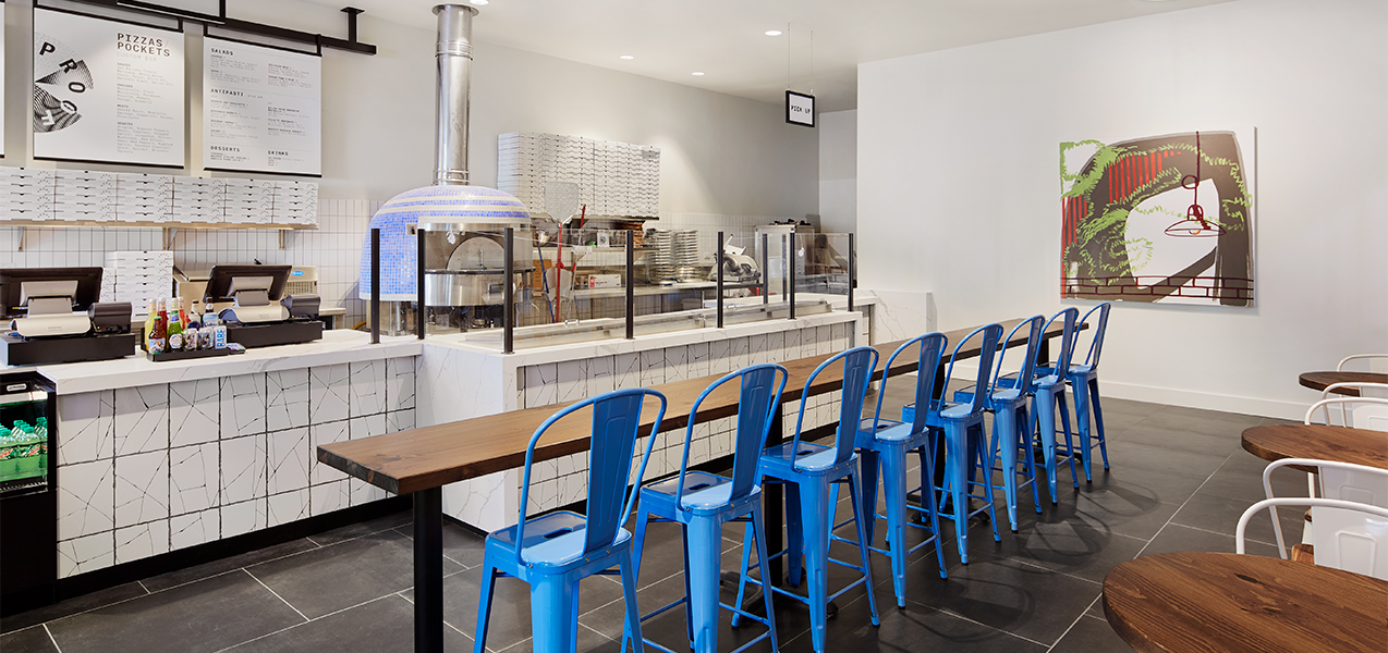 Cafe area with seating as remodeled by Tri-North Builders for the Saint Kate hotel in downtown Milwaukee, Wisconsin.