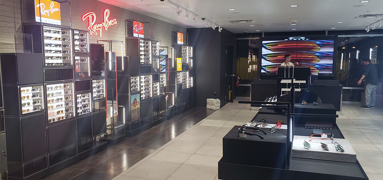 Sunglasses are displayed on shelves and tables at Sunglass Hut, a Tri-North project.