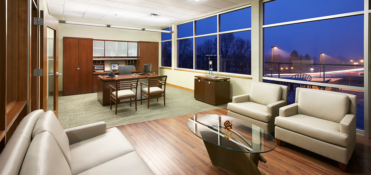 Large executive office with sitting area inside the Tri-North Builders headquarters in Wisconsin.