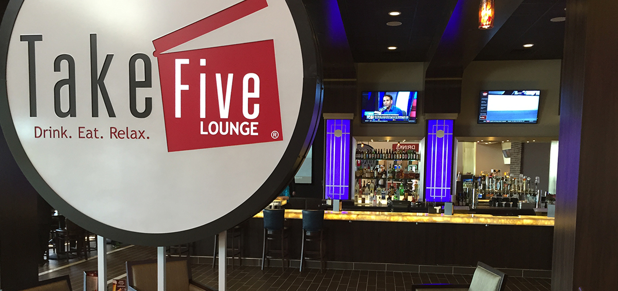 Bar and sign inside the Take Five Lounge in Madison, WI, as built by Tri-North Builders.