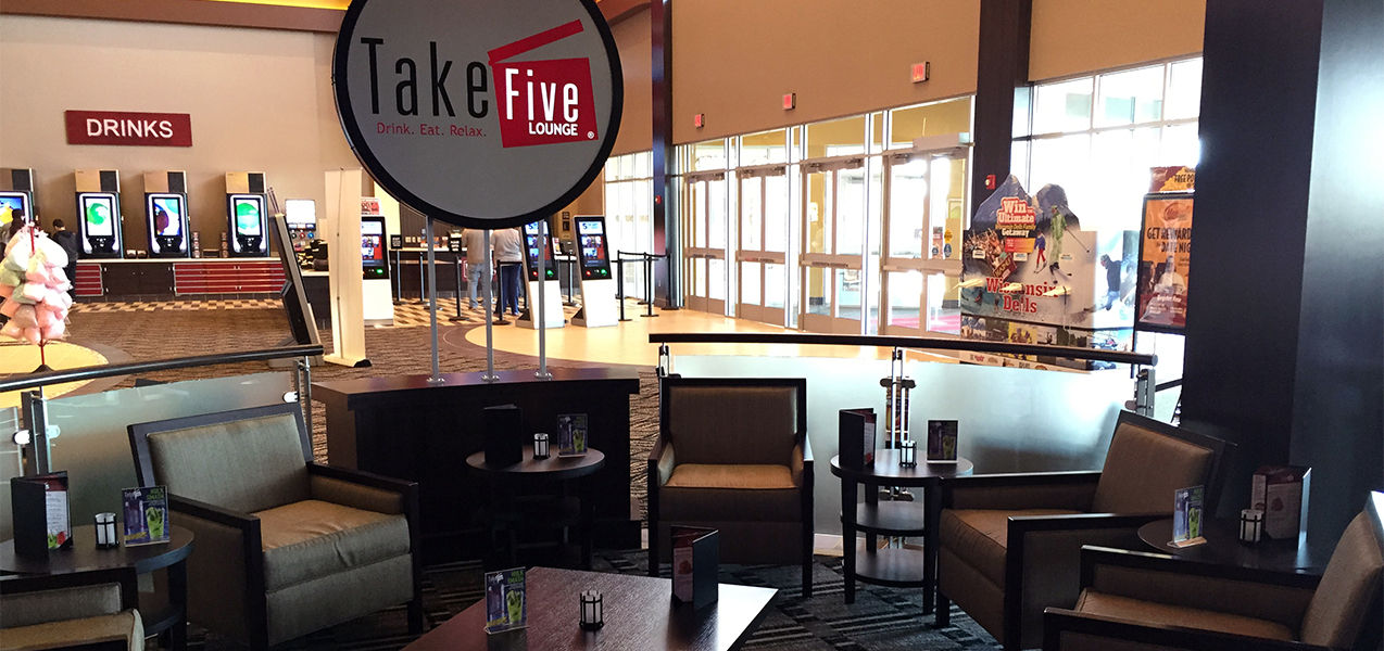 Circular seating area showing front entrance of the Take Five Lounge in Madison, Wisconsin, built by Tri-North.