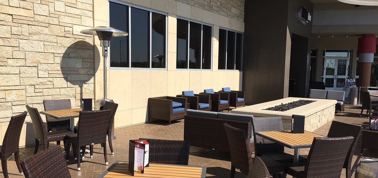 Outdoor patio and seating area of the Take Five Lounge in Madison, WI, a Tri-North Builders project.