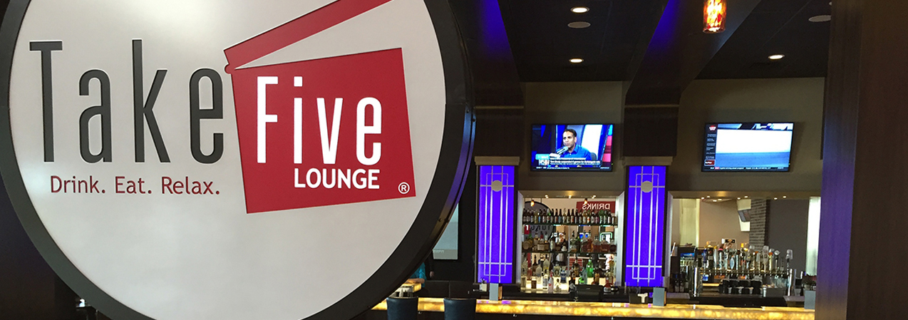 Bar and sign inside the Take Five Loung in Madison, WI, as built by Tri-North Builders.