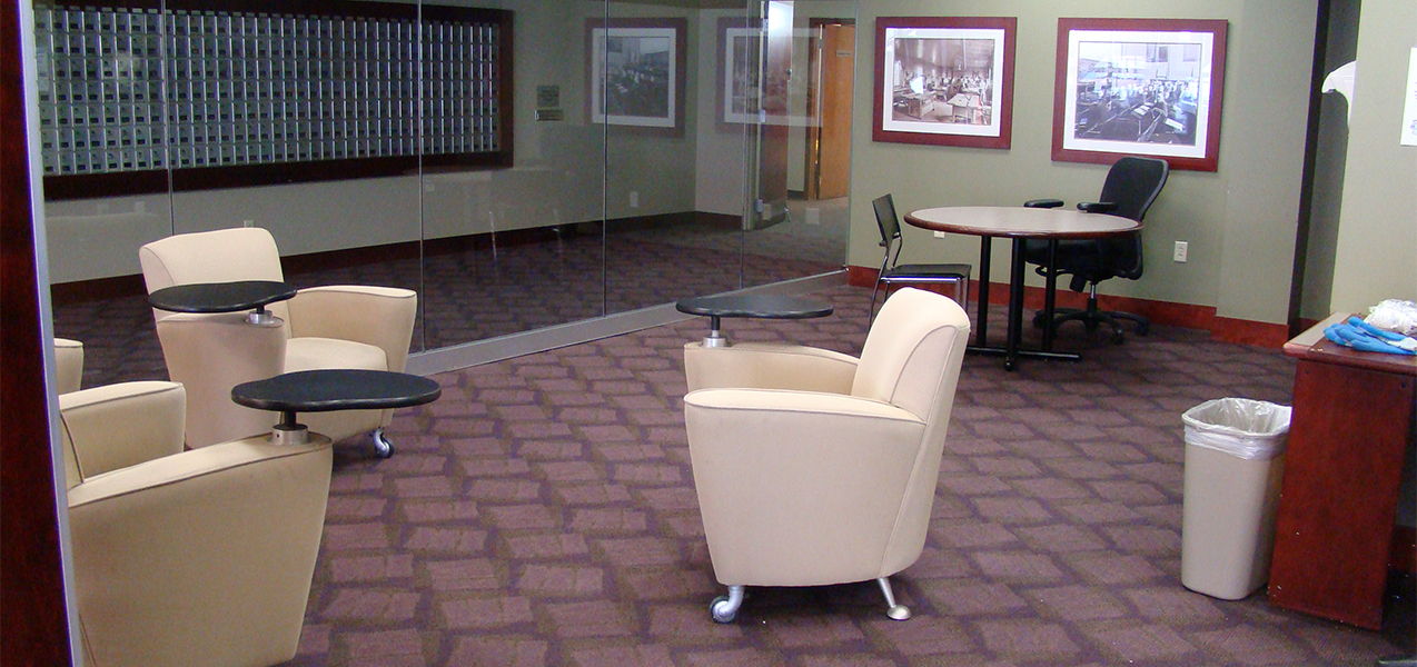 Meeting room with chairs and desks inside The Towers apartment building in Madison, WI.