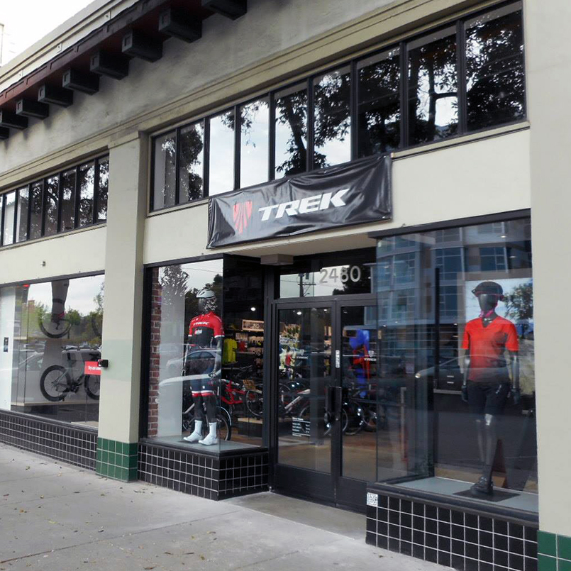 Mannequins stand in the windows at the entrance to a Trek bike store built by Tri-North.