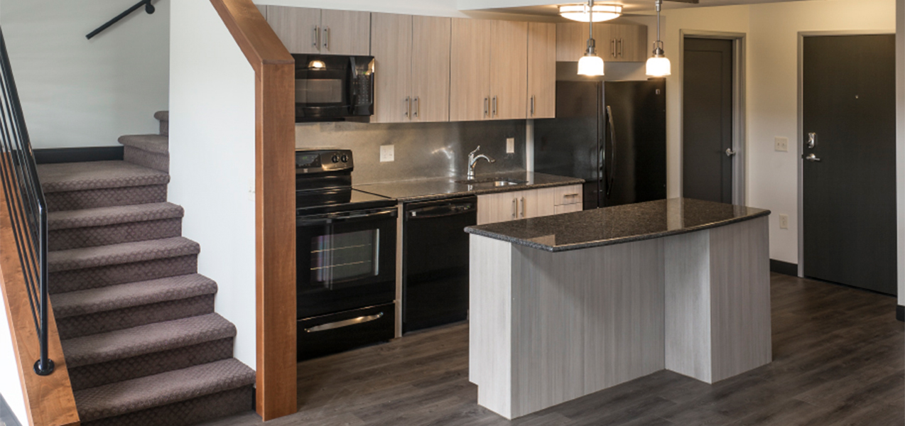 Tri-North Builders remodeled kitchen area inside an apartment at the Treysta on the Water Apartments in Monona, WI.