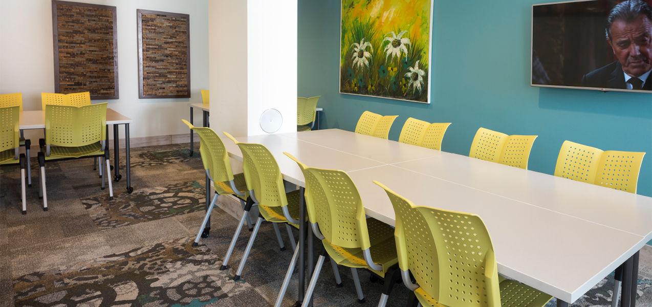 Conference room remodeled by Tri-North Builders inside the Treysta on the Water Apartments in Monona, WI.