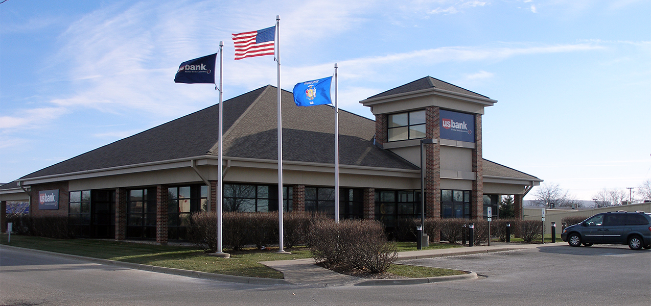 Flags flying over the US Bank building which is a Tri-North Builders project in Wisconsin.