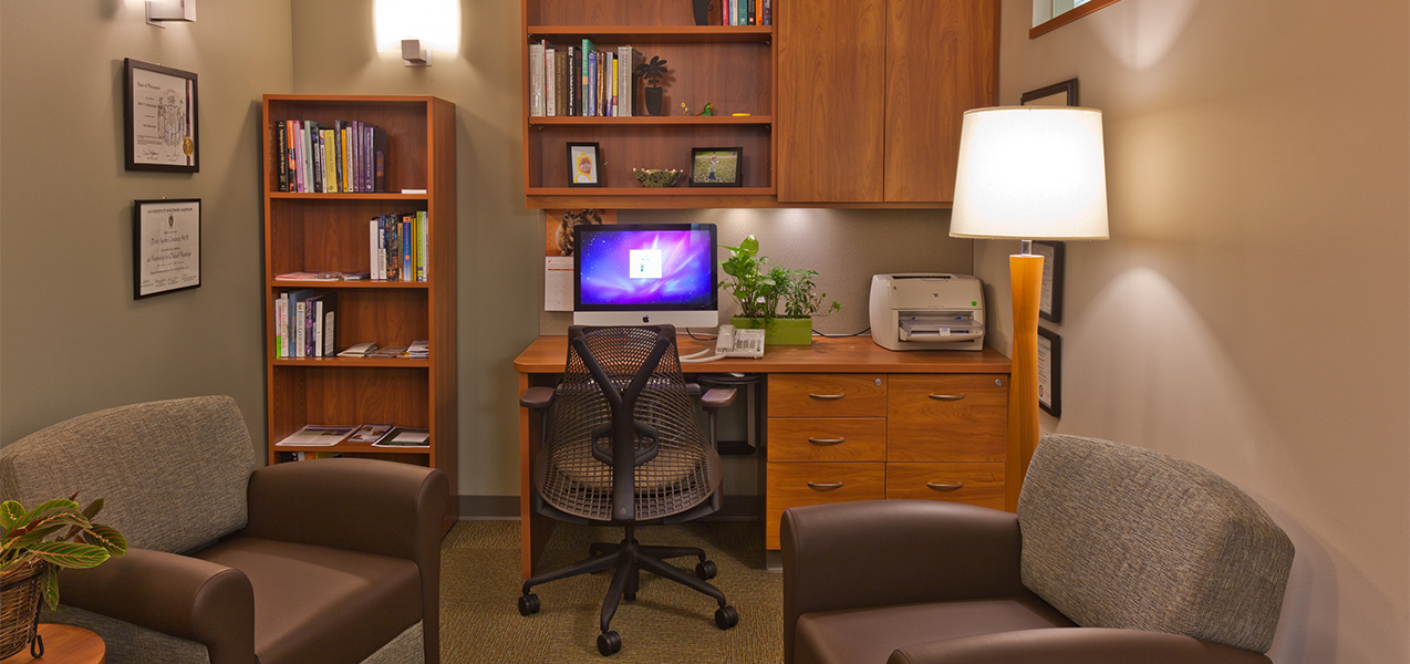 Office area with desk, computer and chairs inside the Tri-North Builders remodeled UW Cancer Center in Madison, WI.