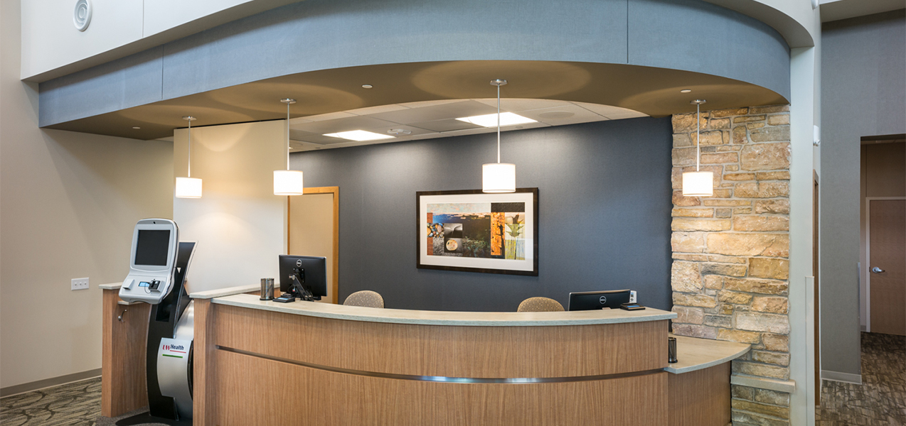 Reception desk and patient registration area inside the UW Health Cottage Grove clinic in Wisconsin.