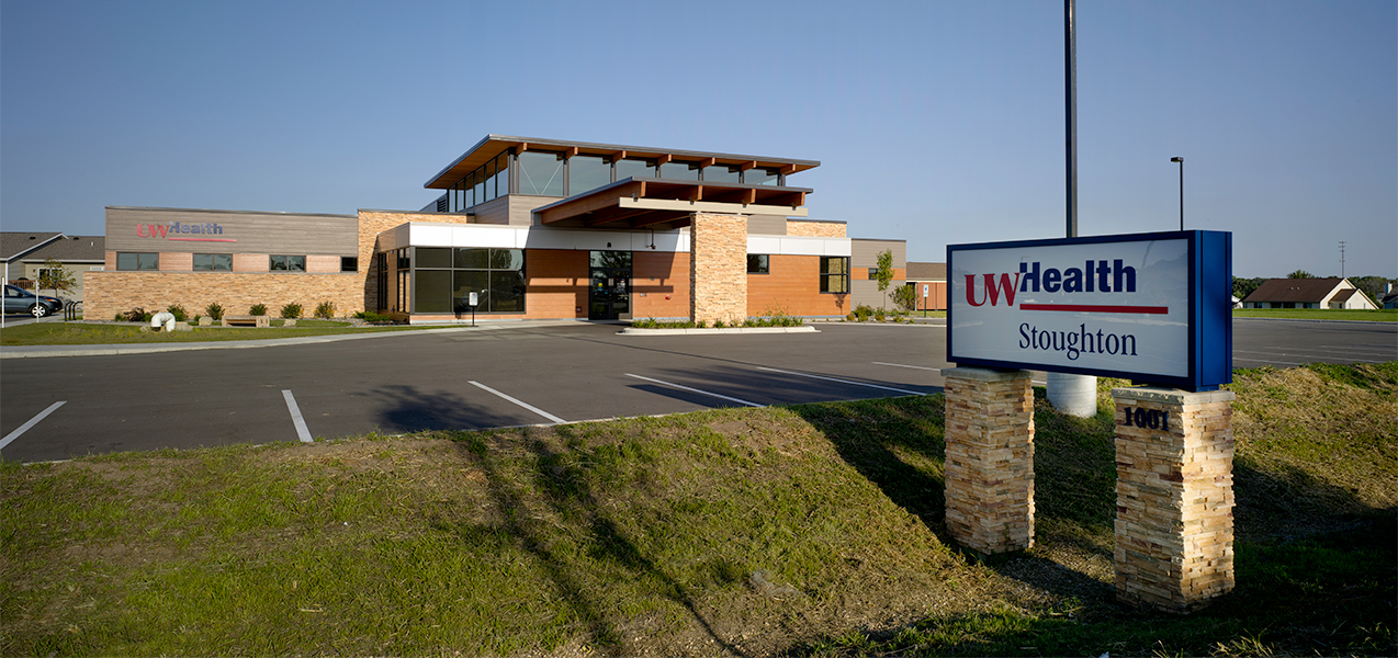 Front of building and parking lot of the UW Health Stoughton Clinic in Wisconsin.
