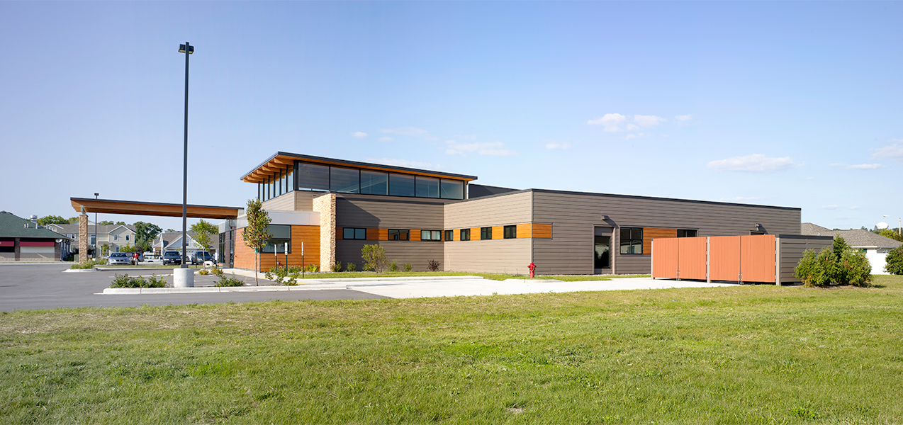 Side of building showing front entrance and drop off at the Tri-North Builders project for UW Health Stoughton Clinic.