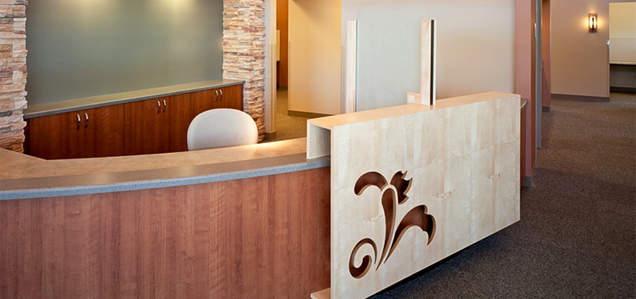 Reception desk and registration area inside the Tri-North Builders remodeled UW Health Stoughton Clinic.