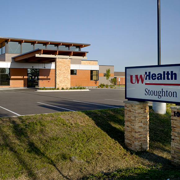 Sign and front entrance of the Tri-North Builders project at the UW Health Stoughton Clinic in Stoughton, WI.