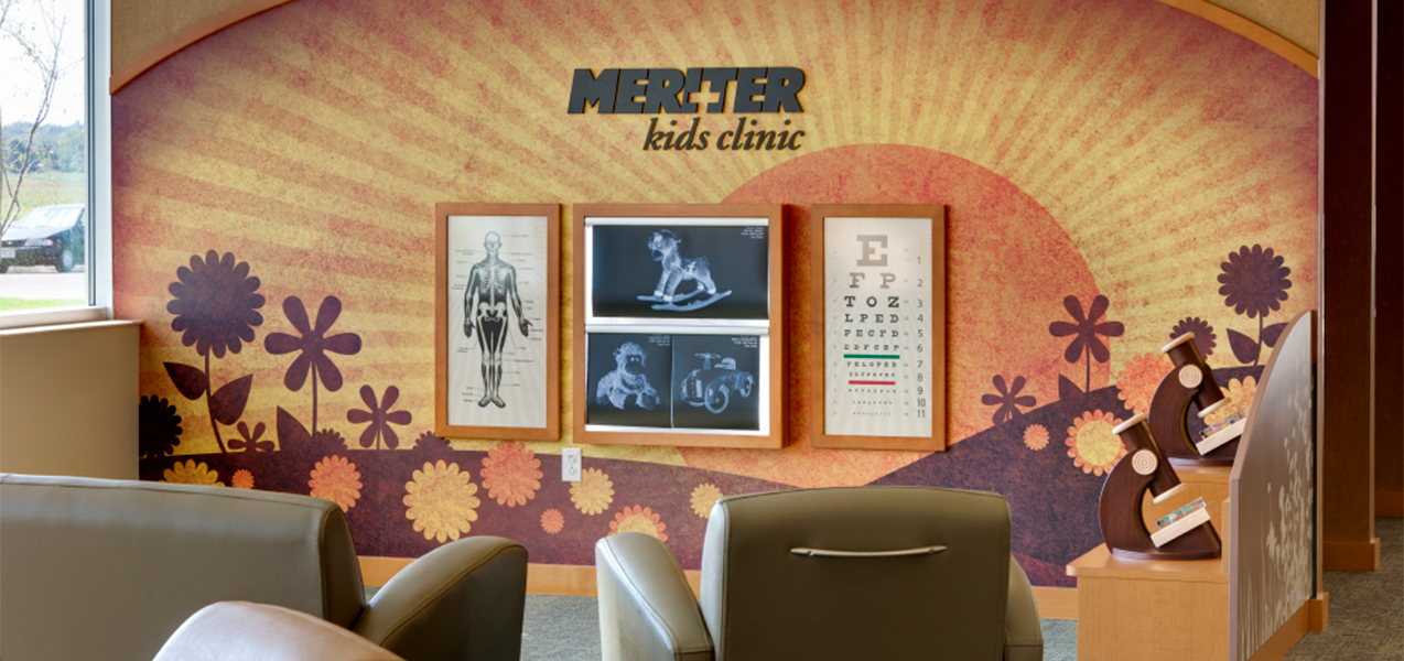 Sign and chairs for the Meriter Kids Clinic inside the Unity Point Meriter DeForest Clinic by Tri-North Builders