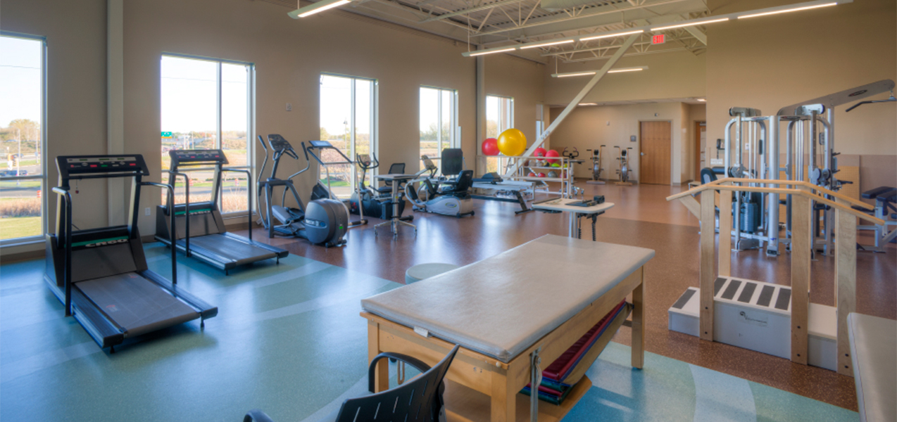 Physical therapy room with exercise equipment in the Unity Point Meriter Monona clinic remodeled by Tri-North Builders in Wisconsin.