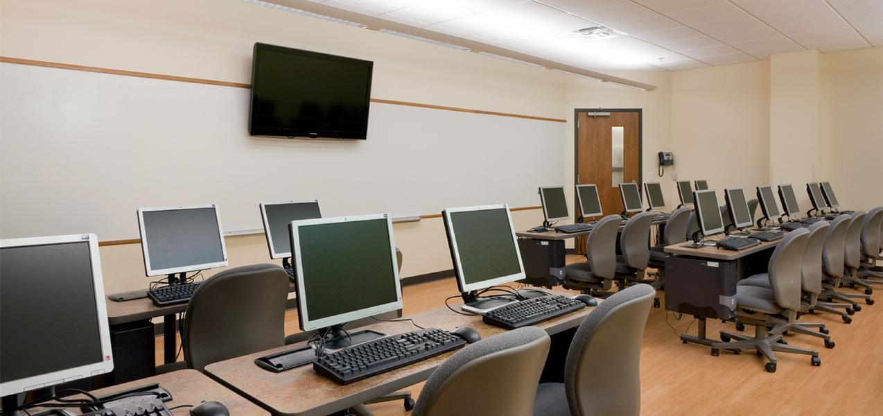 Classroom with computers and tables inside the Madison Urban League building project by Tri-North Builders.