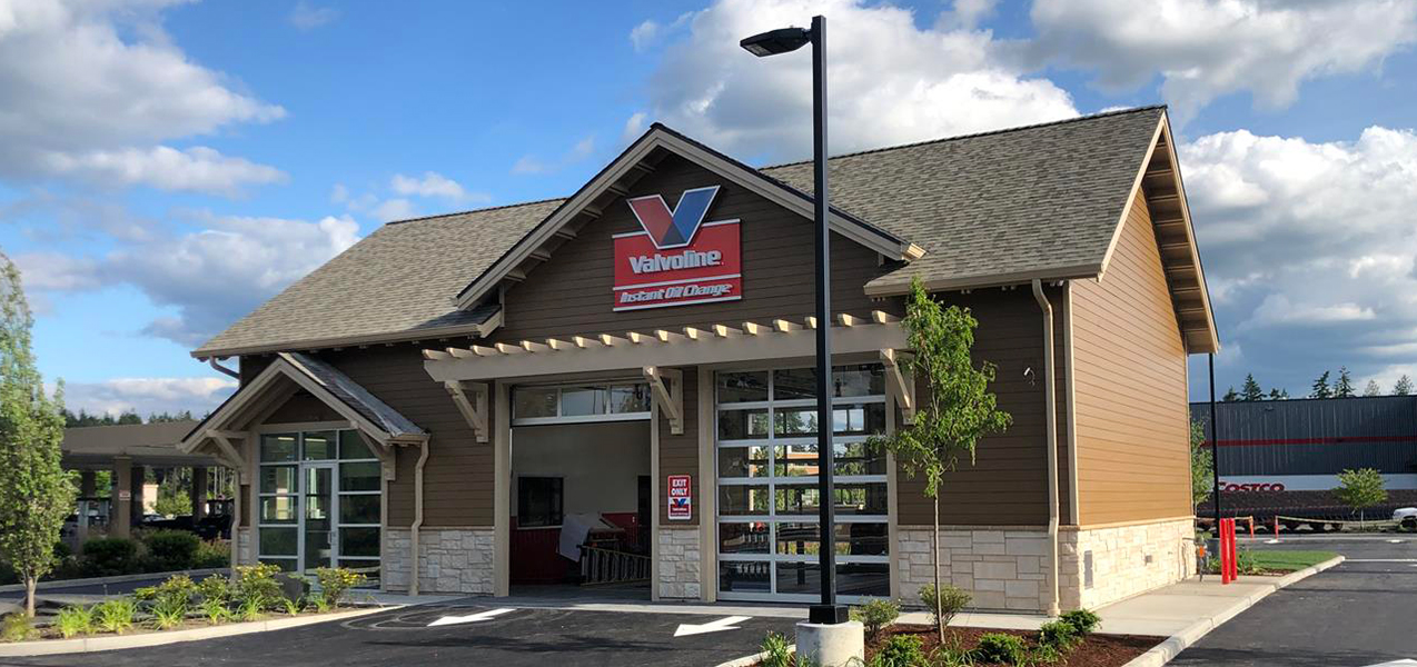 One bay door is open at a Valvoline Instant Oil Change location built by Tri-North builders.