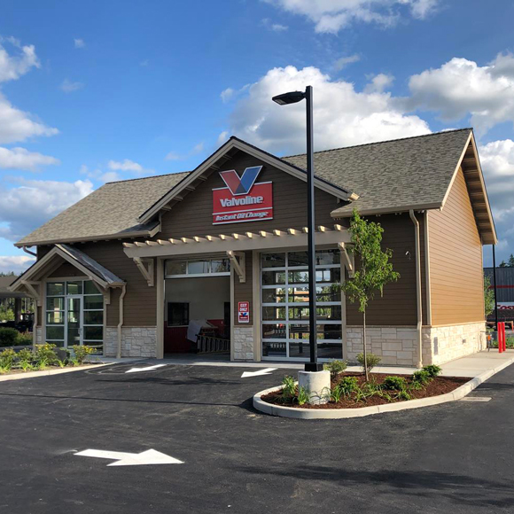 The exterior of a 2-bay Valvoline location, built by Tri-North.