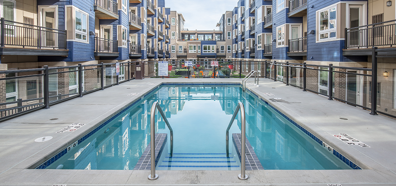 Outdoor pool and courtyard at the newly Tri-North Builders remodeled Veritas Village in Madison.