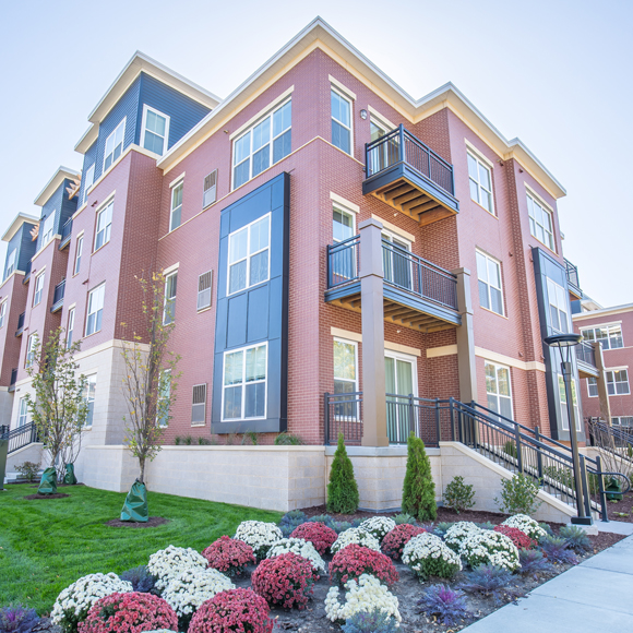 Remodeled building exterior of Veritas Village Apartments in Madison, WI, a Tri-North Builders project.