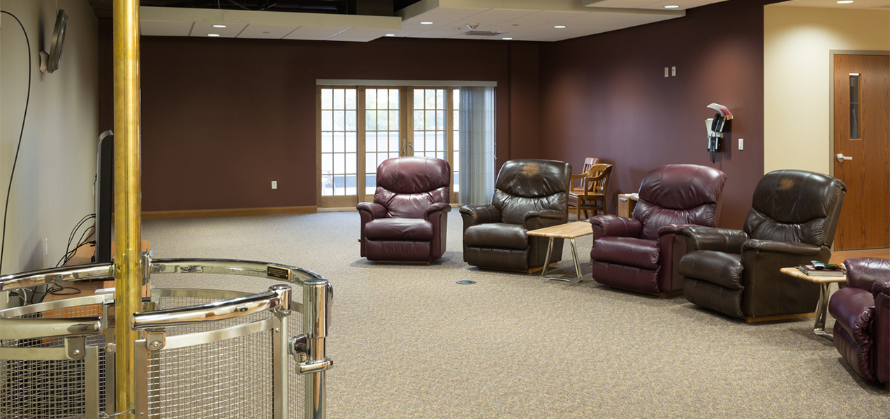 Verona Fire Department fire pole and remodeled sitting area with easy chairs.