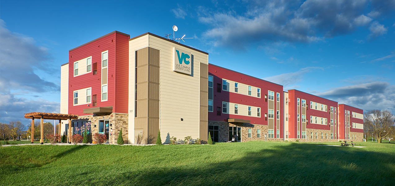 Front and side of the remodeled by Tri-North Builders Vue Campus Student Living building in Wisconsin.