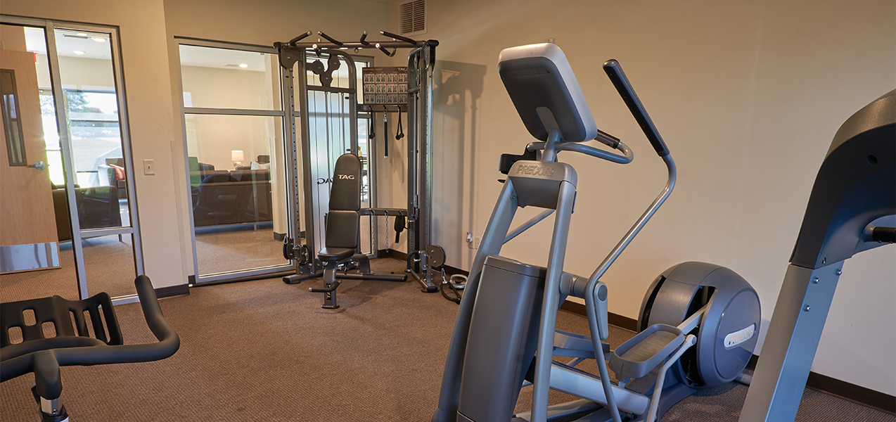 Fitness center and fitness equipment at the Vue Campus Student Living in Fond du Lac, WI, remodeled by Tri-North Builders.