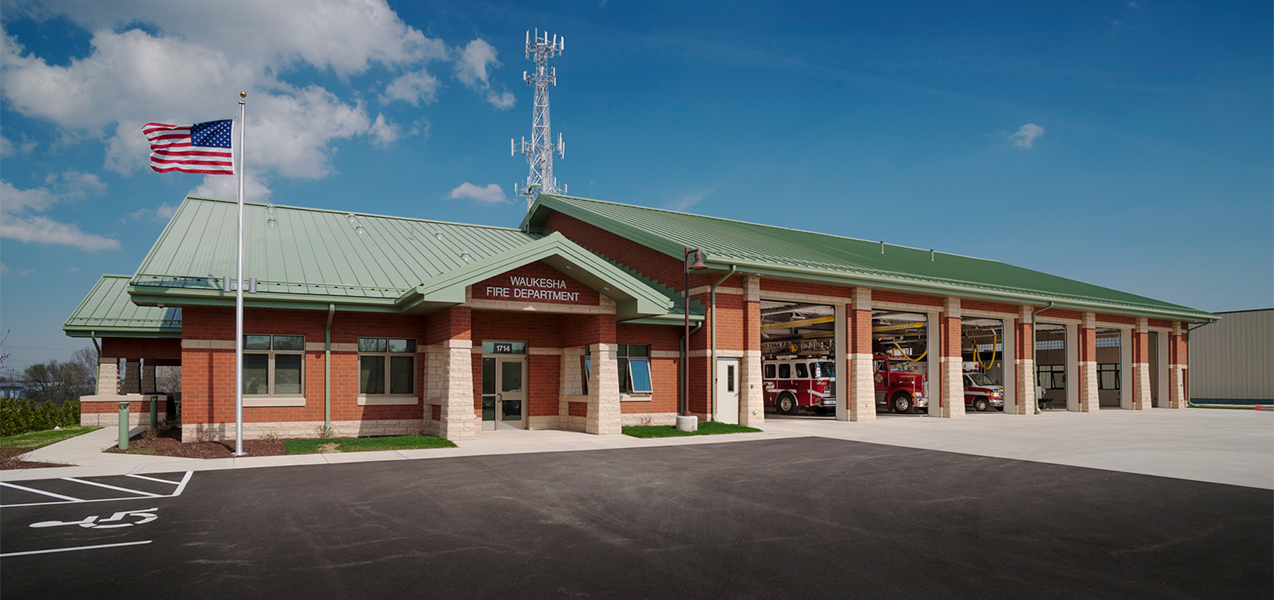 Front of building at Tri-North Builders' Waukesha Fire Department remodel project with fire trucks and garage doors.