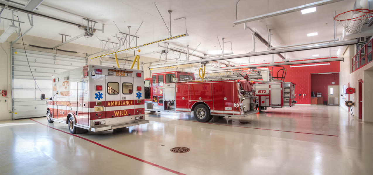 Interior of garage at Waukesha, WI, fire department showing fire truck and ambulance, a Tri-North project.