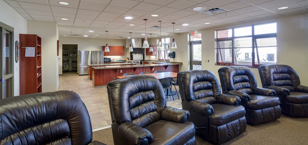 Waukesha, WI, fire department station sitting area with leather easy chairs and windows.