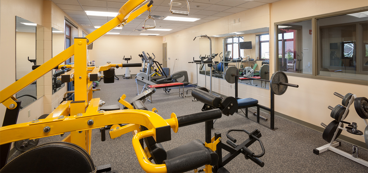 Tri-North Builder's Waukesha Fire Department project photo showing remodeled workout room with equipment.