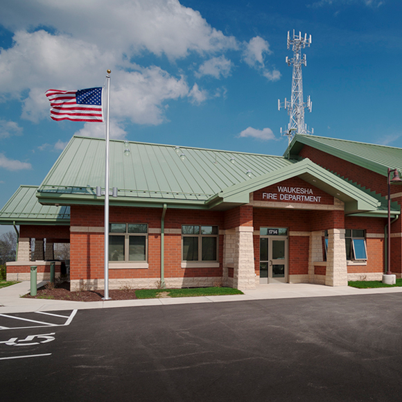 Waukesha, WI, fire department fire station front door and flagpole. Tri-North Builders remodeled this project.