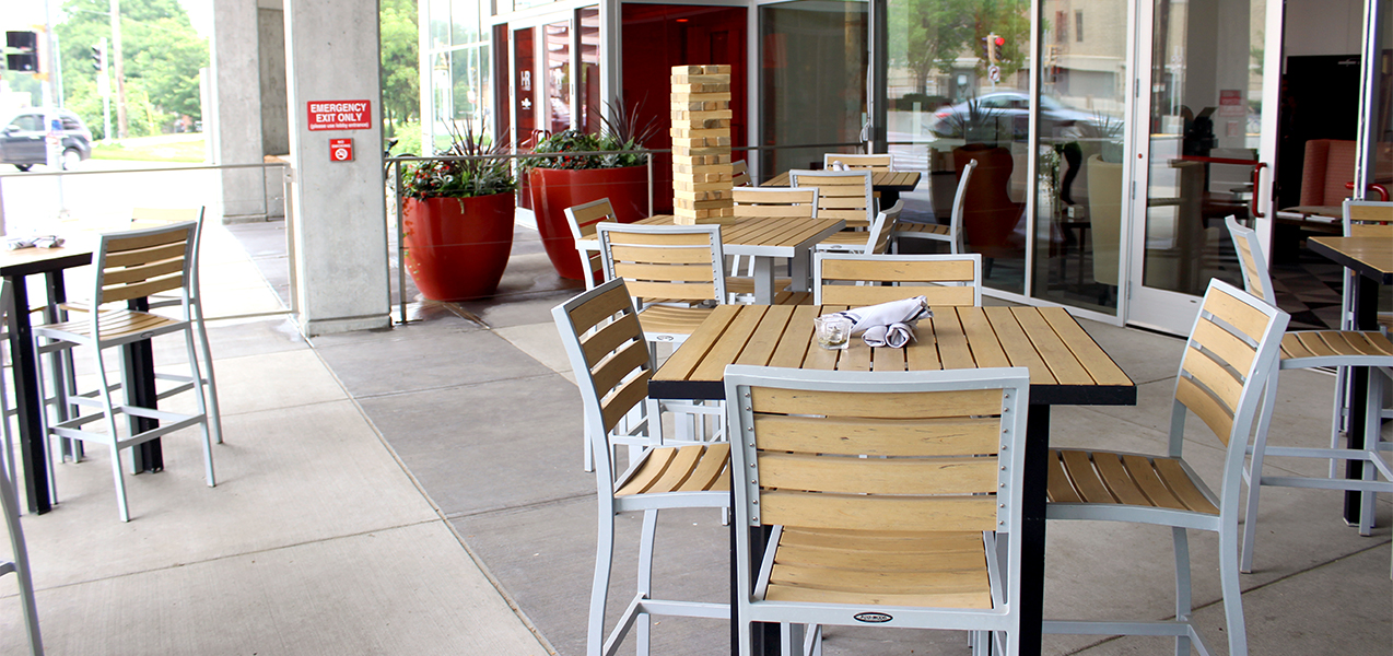 Outdoor patio tables and chairs at The Wise at Hotel Red restaurant in Madison, WI.