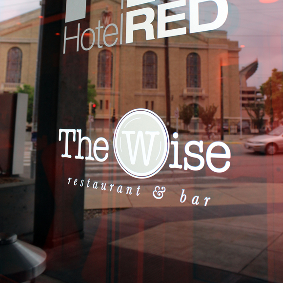 The Wise at Hotel Red front window with logo in Madison, WI, a Tri-North Builders project.