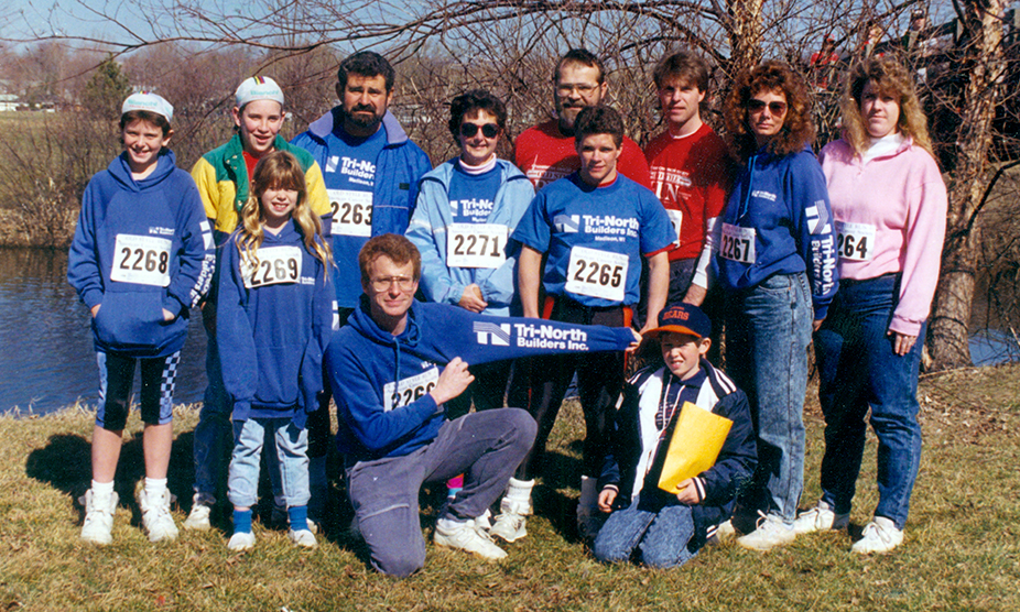 A team of Tri-North employees and family members pose together at a local community event.