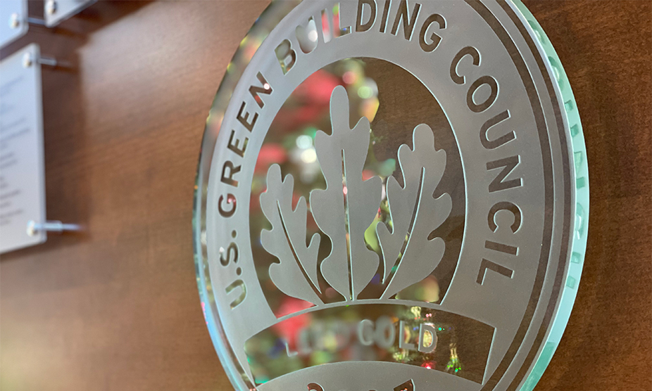 A glass plaque featuring the seal of the US Green Building Council represents Tri-North's LEED certification.