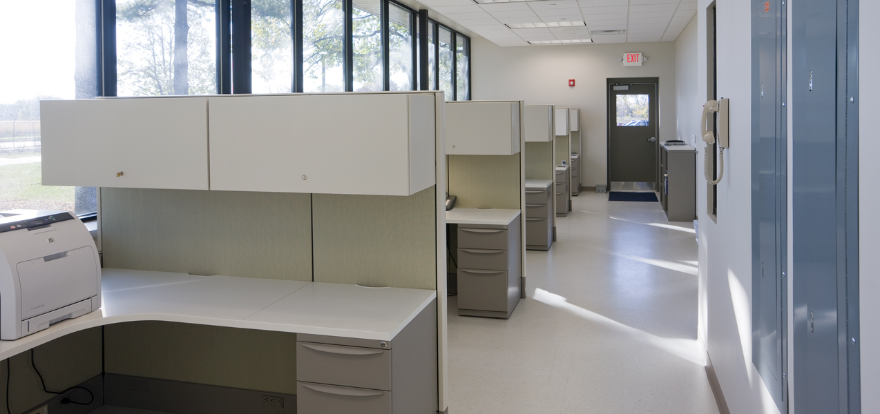 Cubicles line a wall with floor-to-ceiling windows in the Danisco building in Madison, Wisconsin.