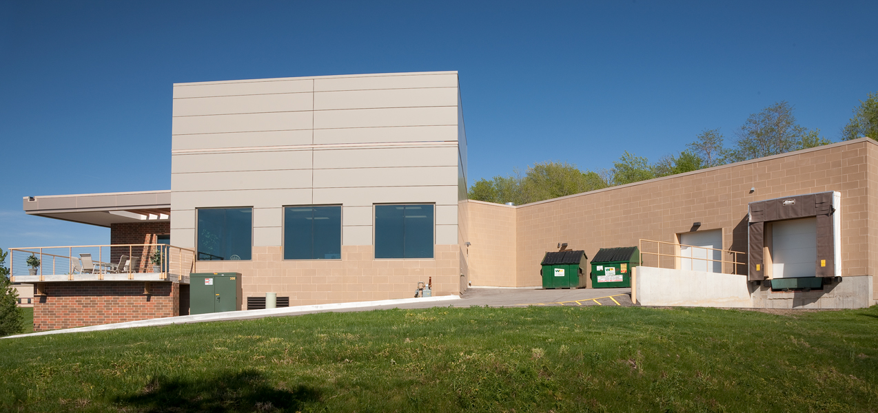 A refuse area, garage and loading dock are tucked around the back of the PIKE Technologies building in Fitchburg, WI.