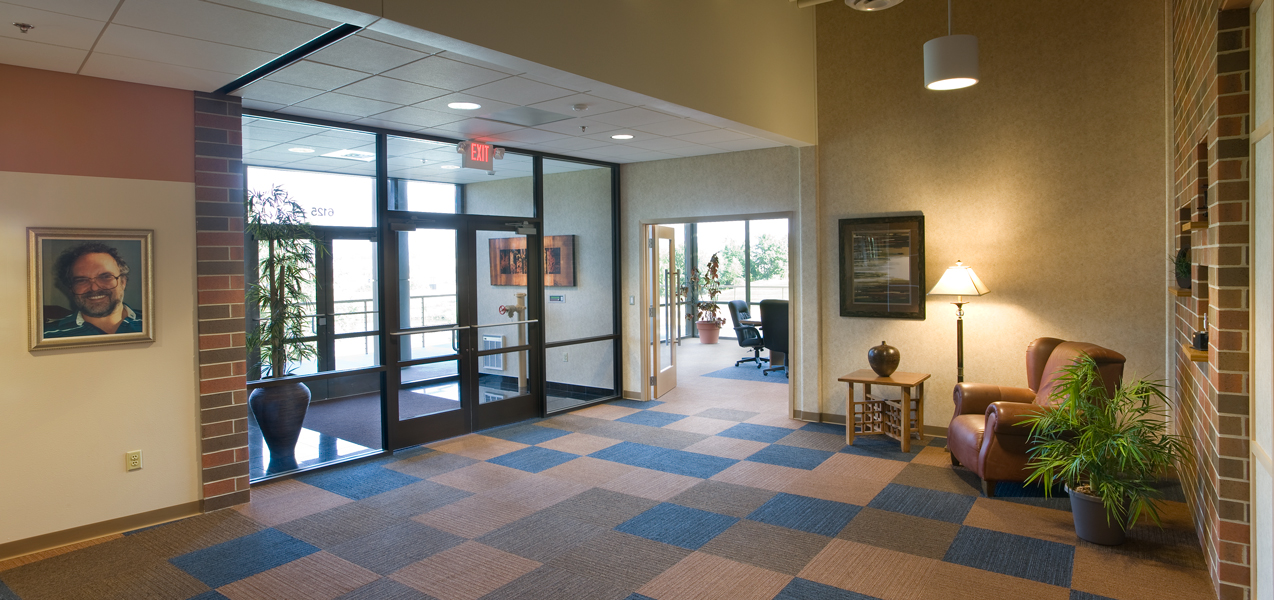 Double glass doors welcome visitors into the lobby of the PIKE Technologies building built by Tri-North.