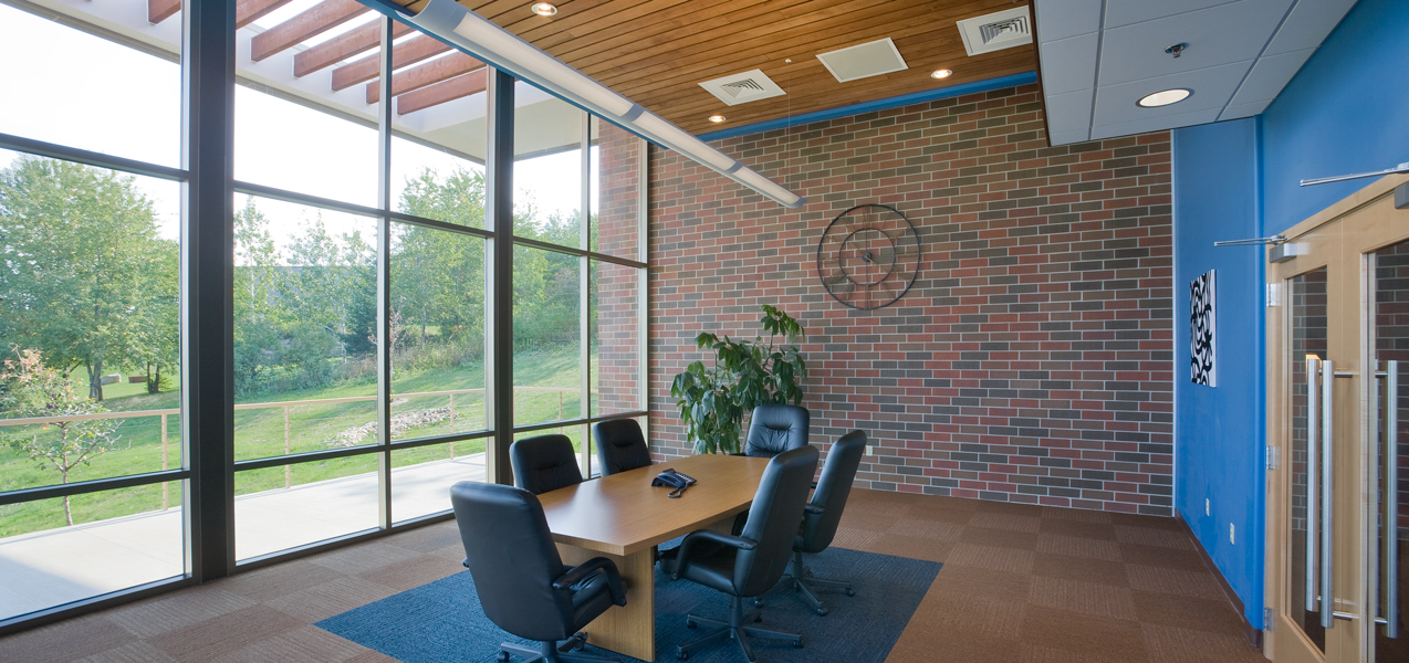 A wall of windows allows lots of light into a PIKE Technologies conference room.